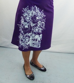 white skull in bloom on purple cotton a-line skirt